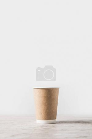 Photo for Disposable coffee cup on marble table on white - Royalty Free Image