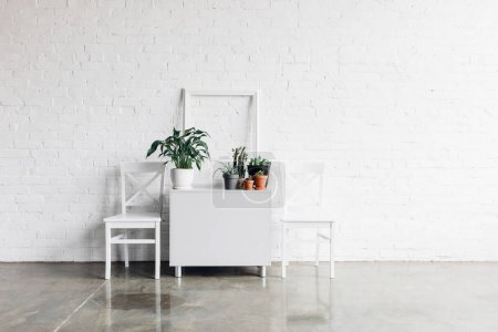 house decor in front of white brick wall, mockup concept
