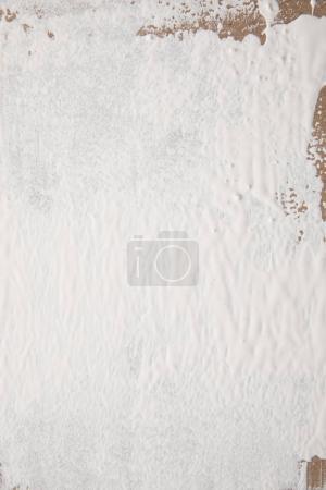 Photo pour Peinture blanche sur la surface de contreplaqué brun - image libre de droit