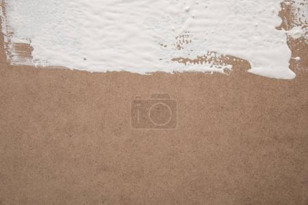 Photo for White paint on brown plywood surface - Royalty Free Image