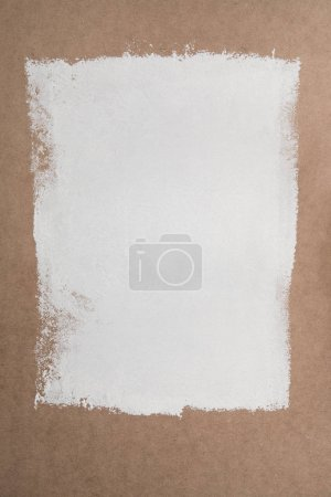 white paint on brown plywood surface