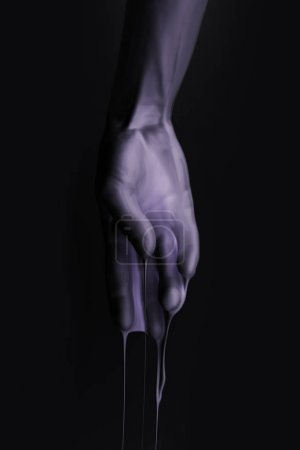 Photo for Cropped image of female hand in purple paint isolated on black - Royalty Free Image