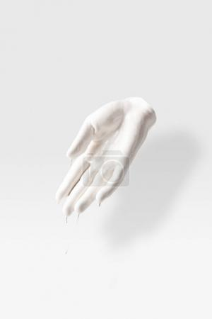 Photo for Abstract sculpture in shape of human arm in white liquid on white - Royalty Free Image