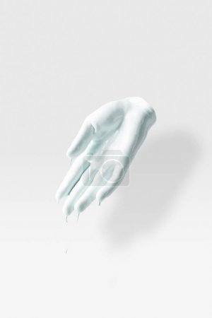 sculpture in shape of human arm in white paint on white