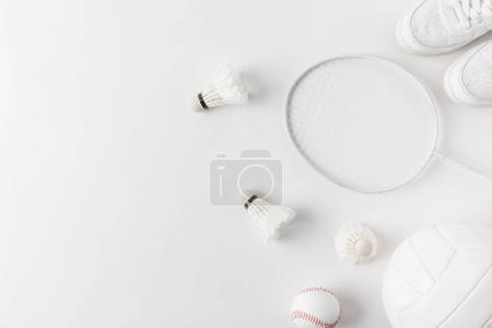 different sports equipment on white surface