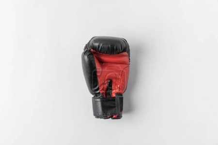 top view of boxing glove on white surface