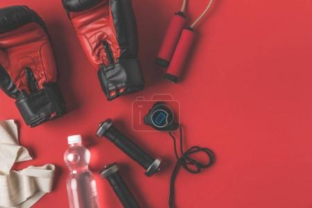 Photo for Flat lay composition of boxer training supplies on red surface - Royalty Free Image