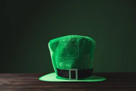 green hat on wooden table, st patricks day concept