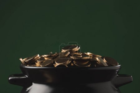 shining golden coins in pot, st patricks day concept