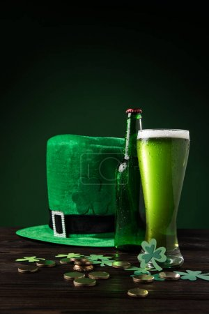 green hat with green beer and coins on table, st patricks day concept