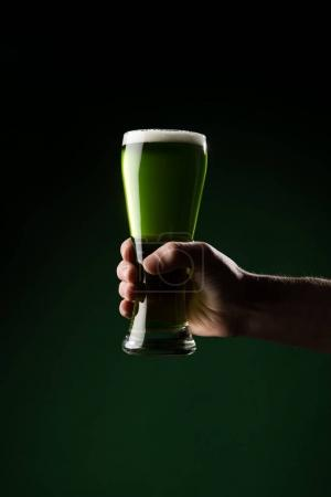 cropped image of man holding glass of green beer, st patricks day concept