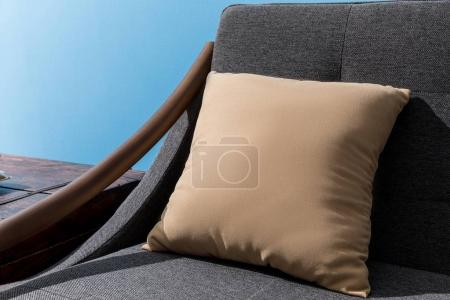 close-up shot of pillow lying on cozy couch