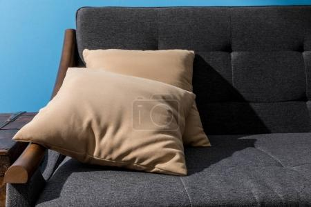 Photo for Close-up shot of pillows lying on comfy couch - Royalty Free Image