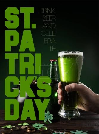 partial view of man with glass of beer and st patricks day lettering