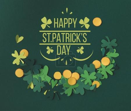 top view of shamrocks and coins with happy st patricks day lettering