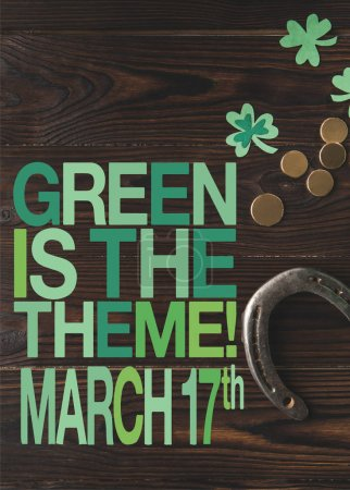 flat lay with coins and horseshoe on wooden tabletop with green is the theme, march 17 lettering