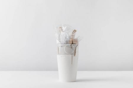 plastic forks in white take away boxes on table