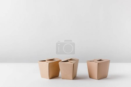 Photo for Three noodles boxes on white surface - Royalty Free Image