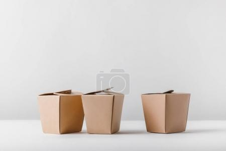 three food containers on white surface