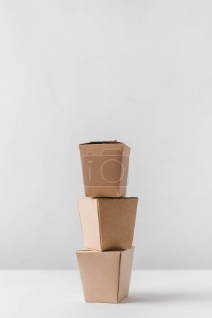 Photo for Three food containers on white table - Royalty Free Image
