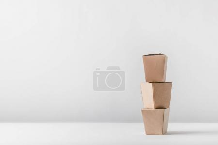 three noodles boxes on white table