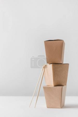 Photo for Three food containers with chopsticks on table - Royalty Free Image