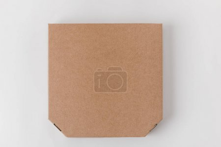 Photo for Top view of brown paper pizza box - Royalty Free Image
