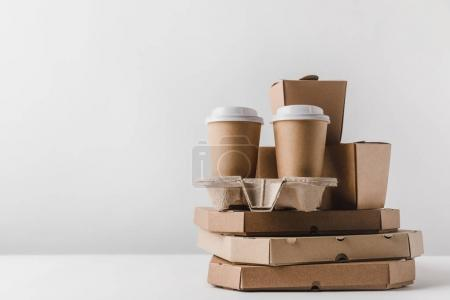 Photo for Pizza boxes and disposable coffee cups with noodles boxes on table - Royalty Free Image