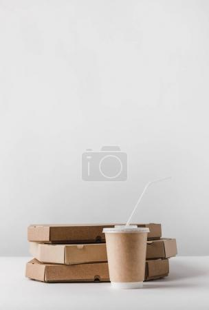 Photo for Pizza boxes and disposable coffee cup on table - Royalty Free Image