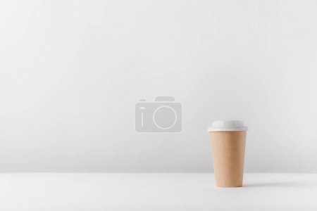 Photo for Disposable coffee cup on white surface - Royalty Free Image