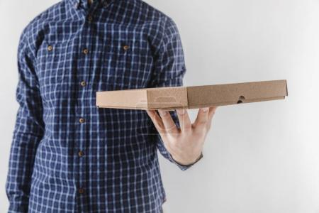 cropped image of courier holding pizza box isolated on white