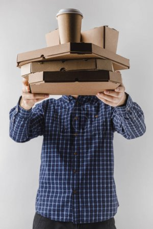 Photo for Courier holding pizza boxes and noodles boxes isolated on white - Royalty Free Image