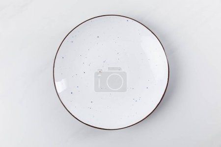Photo for Top view image of plate placed on white surface, minimalistic conception - Royalty Free Image