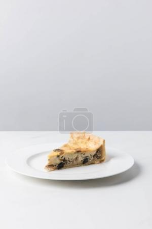 Photo for Closeup view of delicious pie on plate placed on white surface - Royalty Free Image