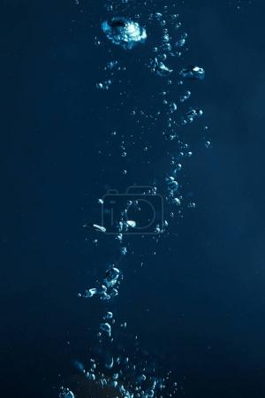 Photo for Full frame of dark water with bubbles background - Royalty Free Image
