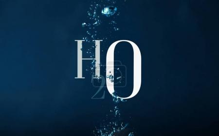h2o chemistry symbol and bubbles in water background