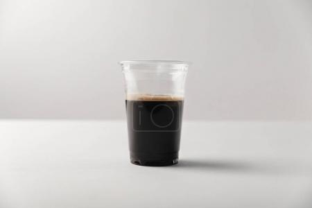 Photo for Disposable cup with black coffee on white background - Royalty Free Image