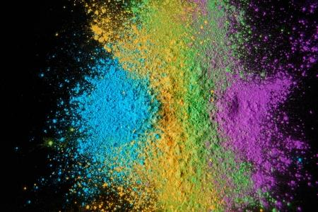 top view of colorful holi powder isolated on black, Hindu spring festival