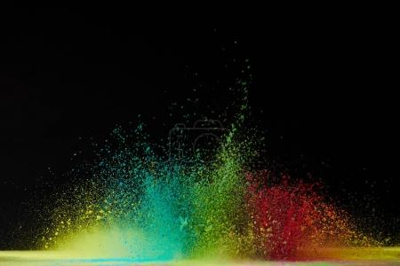 Photo for Colorful holi powder explosion on black, festival of colours - Royalty Free Image