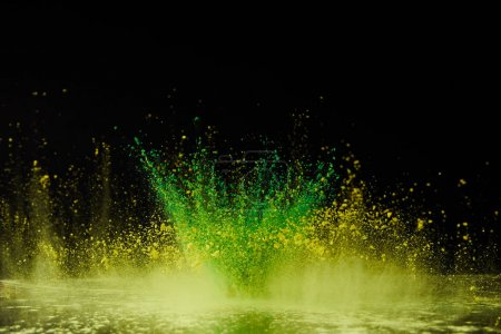 yellow and green holi powder explosion on black, Hindu spring festival
