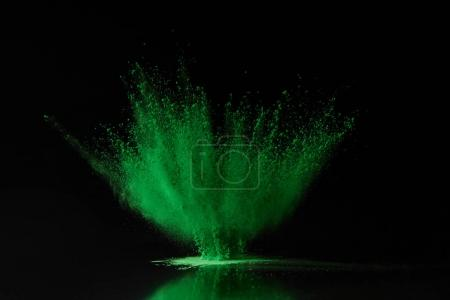 Photo for Green holi powder explosion on black, Hindu spring festival - Royalty Free Image