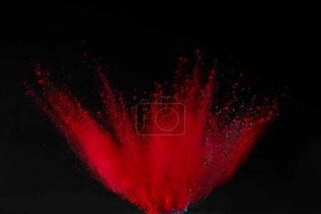 red holi powder explosion isolated on black, festival of colours