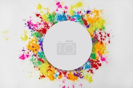 circle frame of colorful traditional powder, isolated on white, traditional Indian festival of colours