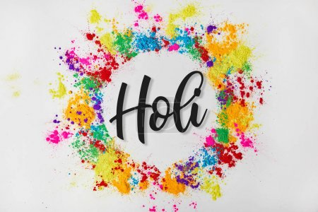 Photo for Circle frame of colorful traditional paint with Holi sign, isolated on white, Hindu spring festival of colours - Royalty Free Image