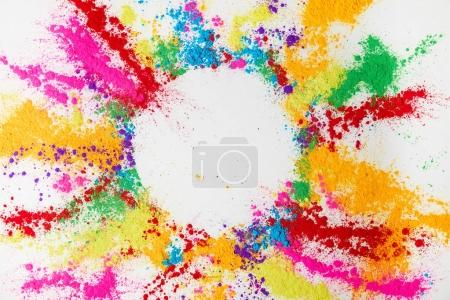 Photo for Circle frame of multicolored traditional powder, isolated on white, holi festival - Royalty Free Image