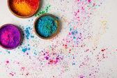 """Постер, картина, фотообои """"вид сверху традиционных Холи краски в чаши, изолированные на белый, индуистской весенний фестиваль цветов"""""""