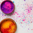 Top view of colorful holi powder in bowls isolated...
