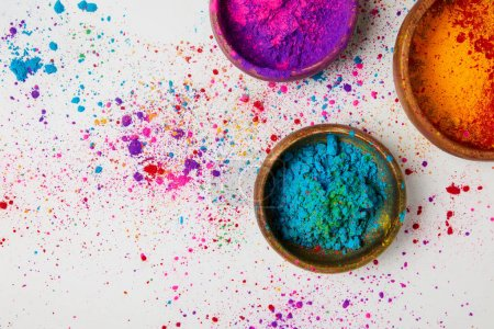 Photo for Top view of traditional holi powder in bowls isolated on white, Hindu spring festival - Royalty Free Image