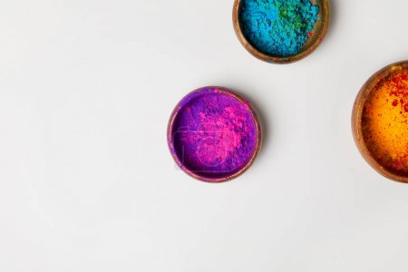 top view of colorful holi powder in bowls isolated on white, Hindu spring festival