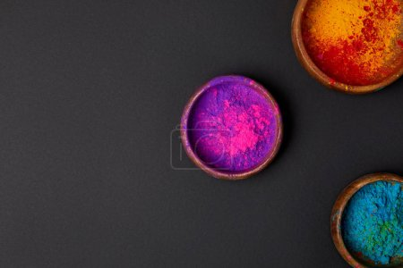Photo for Top view of holi powder in bowls on grey surface, Hindu spring festival of colours - Royalty Free Image